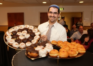 In the name of non-profits, Elie Klein has been eating dozens of donuts since before the start of Hanukkah. (Courtesy of Yissachar Ruas)