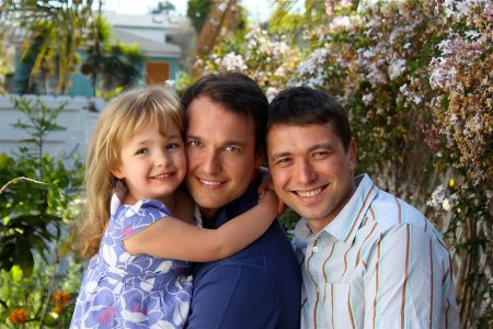 Lawyer Lavi Soloway, center, and his husband, Sebastian Dungan, share a daughter who will soon turn 6. (Albane Navizet)