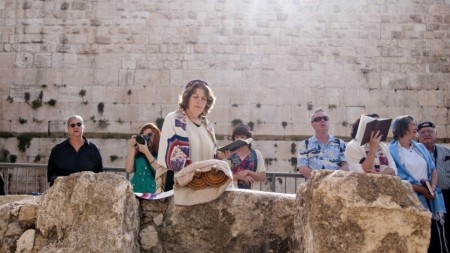 Anat Hoffman reads from the Torah at Robinson's Arch near the Western Wall (photo credit: Hadas Parush/Flash90)