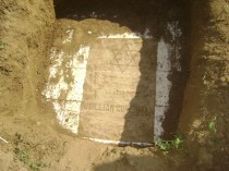 The unearthed gravestone