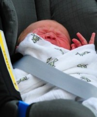 Prince in a Car Seat: The newest British royal is whisked away from the hospital. Will he face the knife anytime soon?