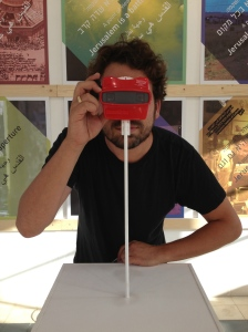 Designer Tal Erez looking at one of his View-Master reels.