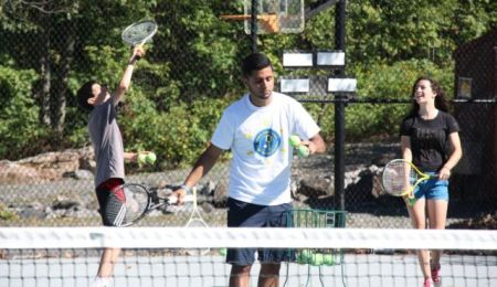 Fahoum Fahoum teaches tennis at Camp Ramah in Canada. (Courtesy)