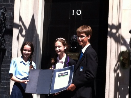 Orli Vogt-Vincent (center) with the 2nd and 3rd place winners of the contest in front of 10 Downing Street. (photo credit: courtesy of Orli Vogt-Vincent)