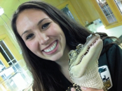 Blair Bazdarich holding a baby American alligator