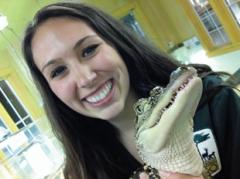 Blair Bazdarich holding a baby American alligator