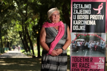 Nela Hasic, pictured here with a Race for the Cure poster, returned from Israel to her native Sarajevo and is leading the fight for breast cancer awareness there. (photo credit: Courtesy of JDC)