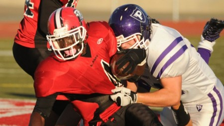 Avi Rosenblum playing football for Albany High School. (photo credit: Ned Purdom/ Courtesy of Rom Rosenblum)
