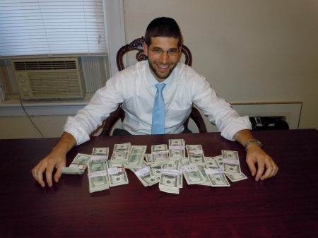 Rabbi Noach Muroff at the desk in which he found $98,000 in cash. (photo credit: Esther Muroff)