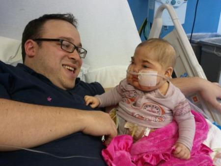 Seth Galena with his daughter Ayelet in the hospital. (Courtesy of Seth Galena)
