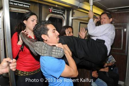Rabbi Sensei Gary Moskowitz shows of some (staged) self-defense moves on the NY subway. (photo credit: Robert Kalfus/Courtesy of Gary Moskowitz)