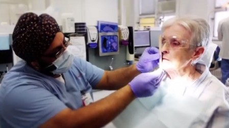 A Sikh dentist treats a patient in Quebec (YouTube screenshot)