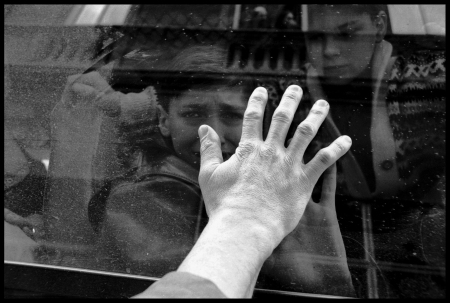 Haris Karalic, a Bosnian Muslim, bidding goodbye to his 13-year-old son Denis, who is leaving Sarajevo on a JDC rescue convoy, February 1994. (photo credit: Edward Serotta)
