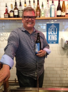 Zane Caplansky shows off his new beer in his eponymous Toronto deli./Renee Ghert-Zand