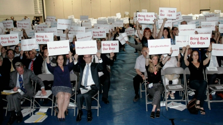 Attendees of rally in Toronto in support of kidnapped Israeli teens, including Israeli Consul DJ Schneeweiss (center left), hold up #BringBackOurBoys signs in English and Hebrew for photo to be sent to the teens' families.(Courtesy of UJA Federation of Greater Toronto)