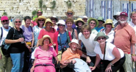 Members of Temple Sinai, Oakland at the Western Wall. Finding a tour bus with a lift and booking wheelchair  accessible rooms enabled Neil and Denise Jacobson (front, center) to join the congregational trip.